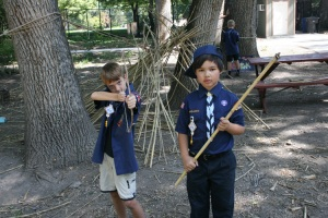 young scouts showing off their primitive weapons they produced in the ArtPark (of their own volition)